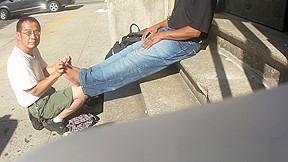 Smelly feet massage outdoors...