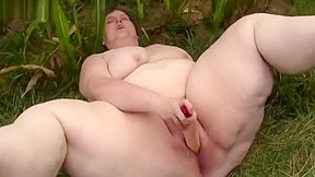 Grandma in a cornfield masturbating with huge dildo...