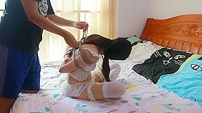 Chinese white lingerie and pantyhose on bed...