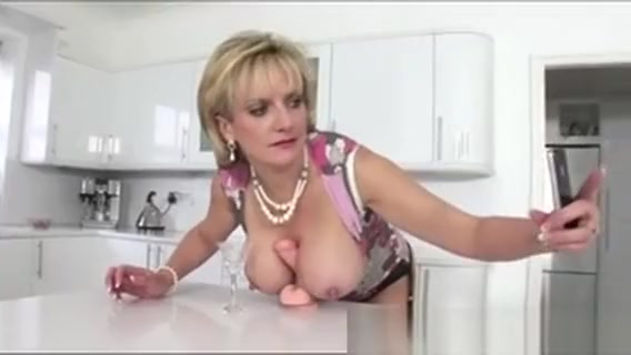 Mature British Slut Titfucks Dildo