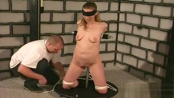Naked Female Stands Yielding And Endures Harsh Bdsm