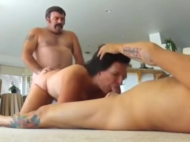 Milf brunette who gets fucked by two guys on the carpet of her living room