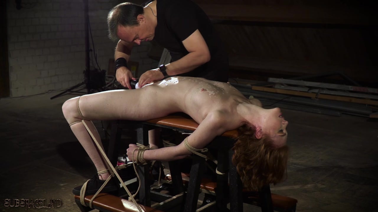 Masochistic redhead enjoys the harsh treatment from her Master A girl nude with not thing on bady