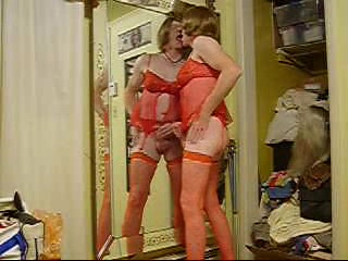 Crazy Crossdresser showing strip and wanking at home