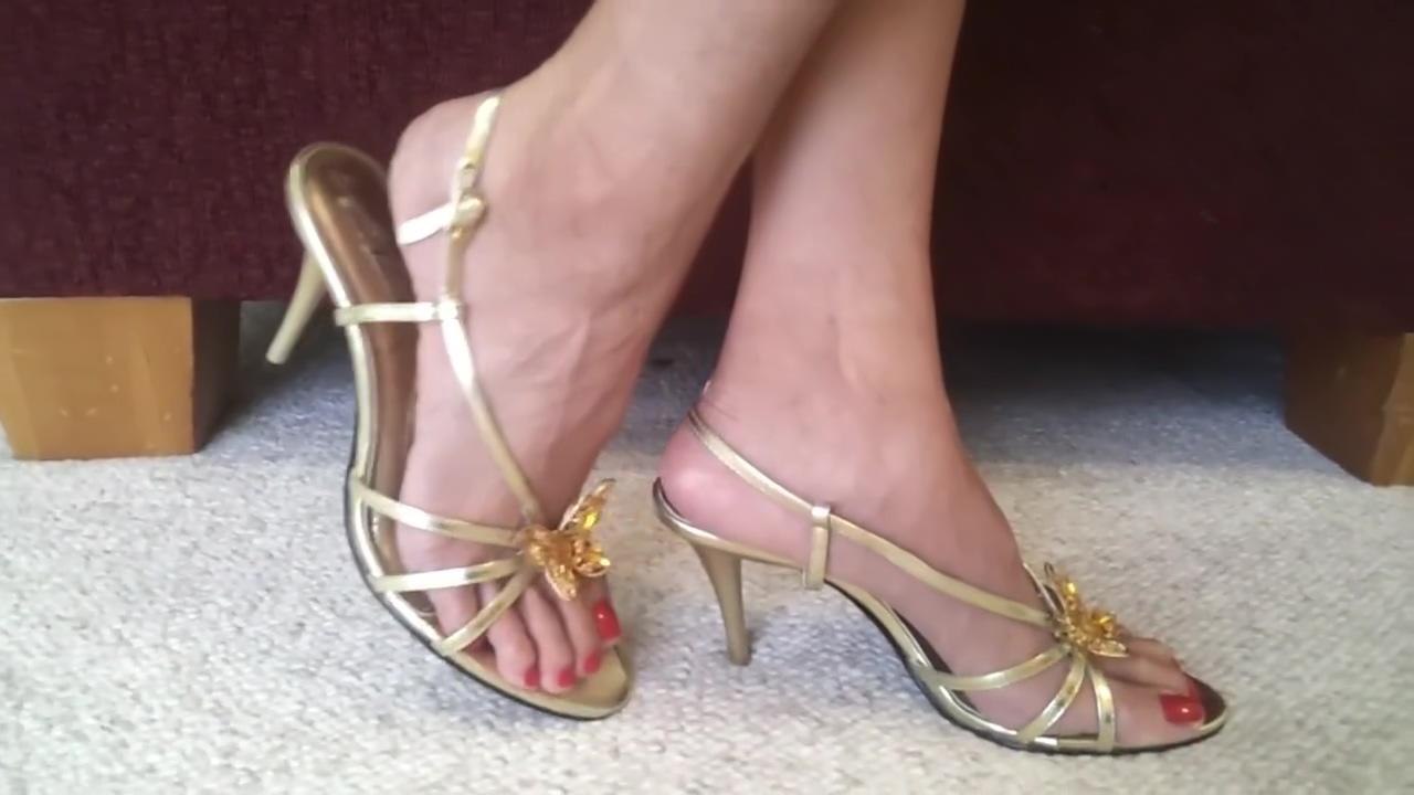 sexy long feet in golden sandals