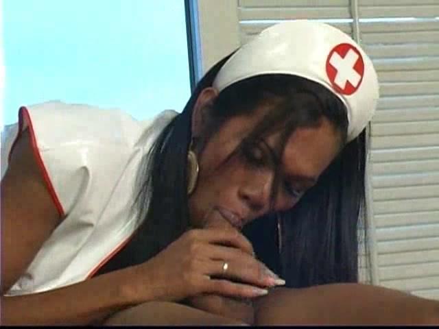Guy drills asian TS nurse on a table