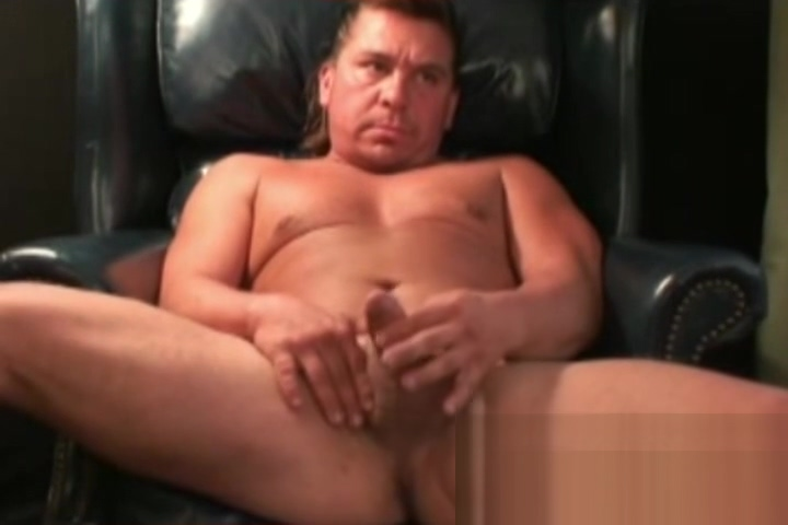 Muscular older guy shows off cock before rubbing it hardcore action with two busty brunettes