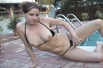 Girl in black thong bikini in swimming pool