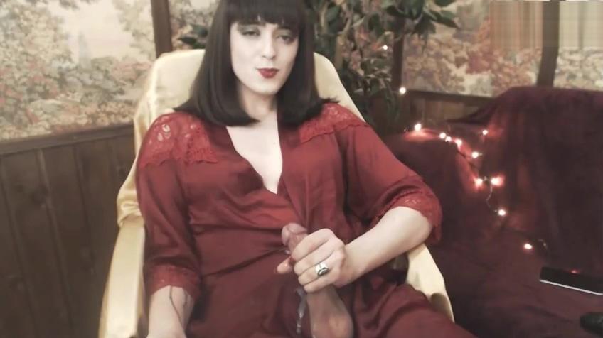 Pretty tgirl in red dress strokes cums