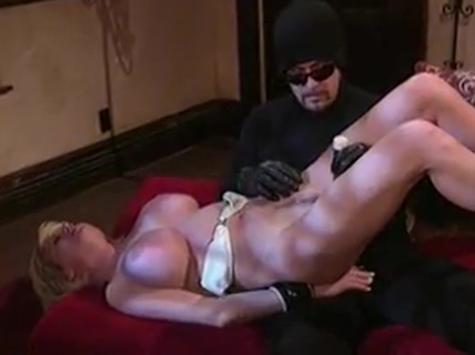 Big tits hottie bound by a masked man for his pleasure
