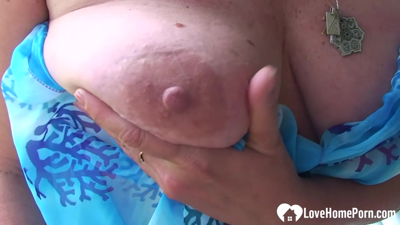 Busty MILF shows her pussy in a close-up
