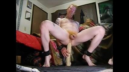A redhead and his big sex-toy Cum bucket slut