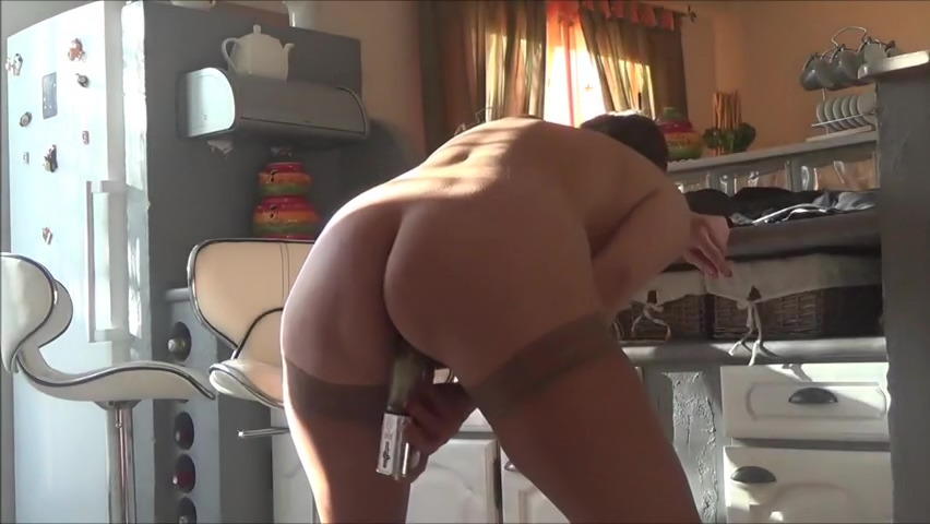 Horny granny masturbating with a sex toy