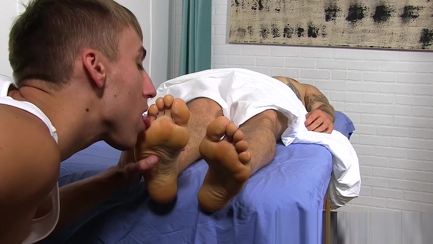 Handsome tattooed jock feet massaged by hunky gay Cabaret lounge ma