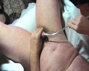 sonding uretral tige Gloved mistress over comes slut