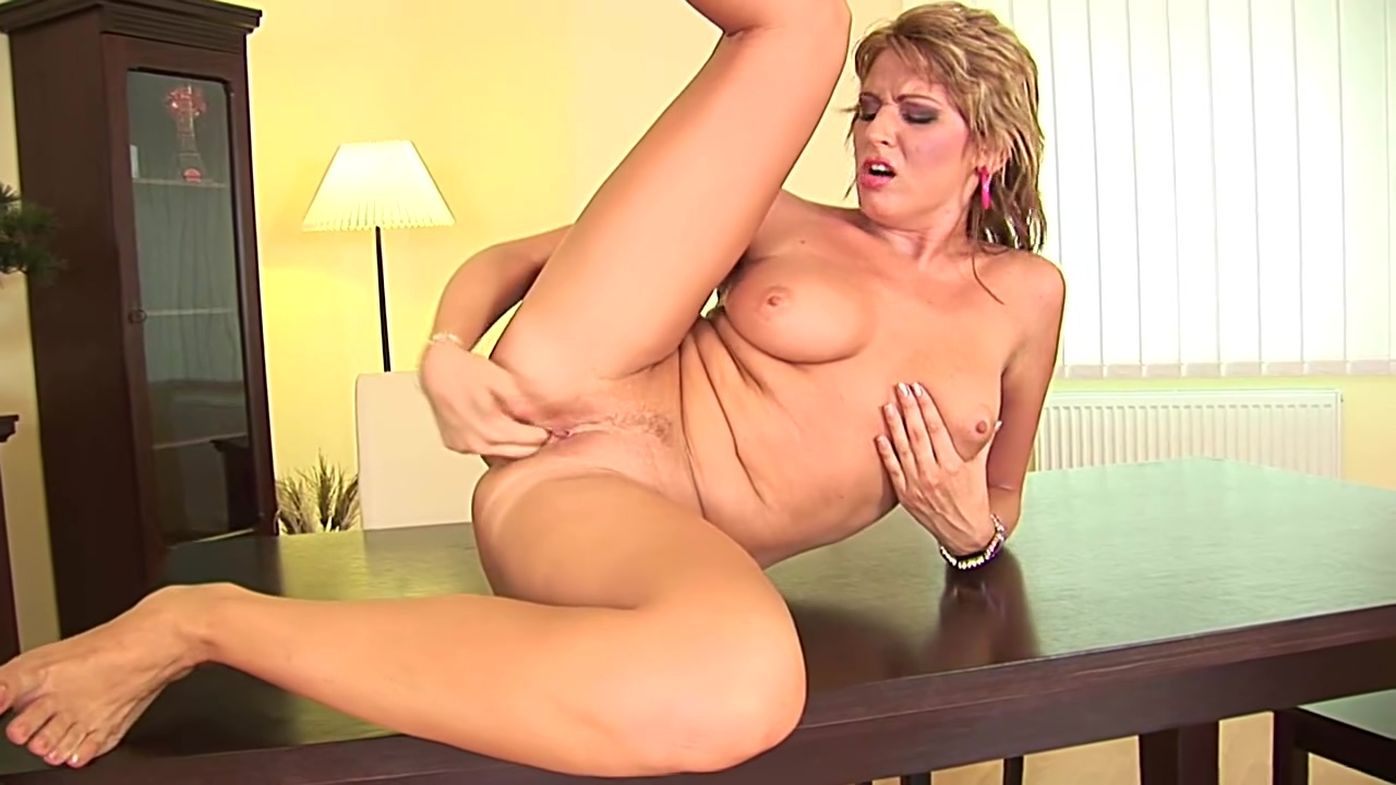 Sweet MILF Julia in pink sexy naked adult stripper