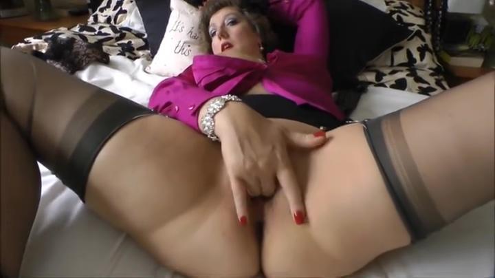 Attractive busty mature female likes to masturbate