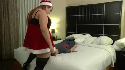 Ms Claus smothering his face sucking boob gif