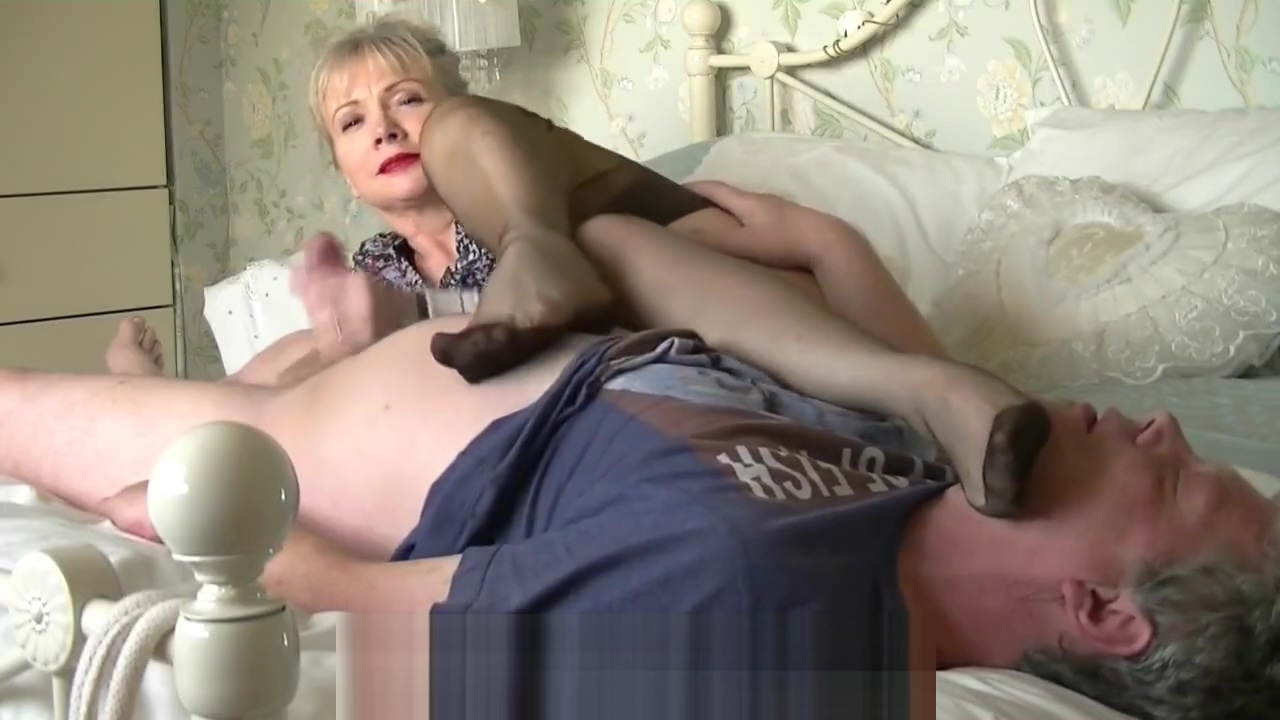 Mature sniffing feet