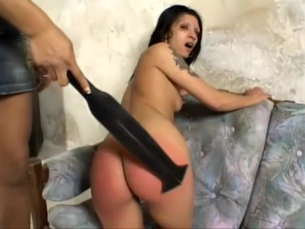 Strict ebony mistress spanks her slave