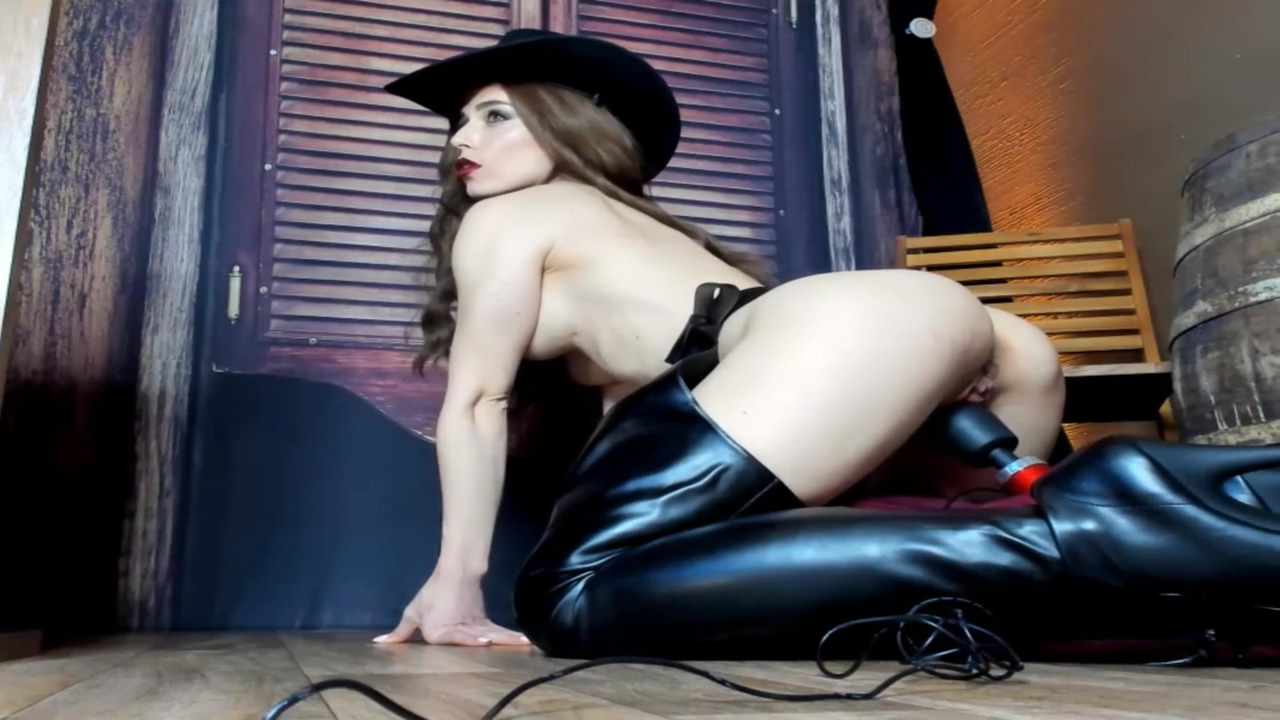 Leather Cowgirl Riding Her Hitachi Horse To Orgasm