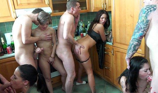 In The Kitchen A Crowd Of Lecherous Swingers Entertains Each Other Org…