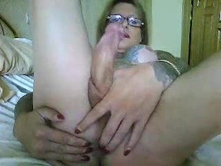 Tattooed aged transsexual strokes her love button