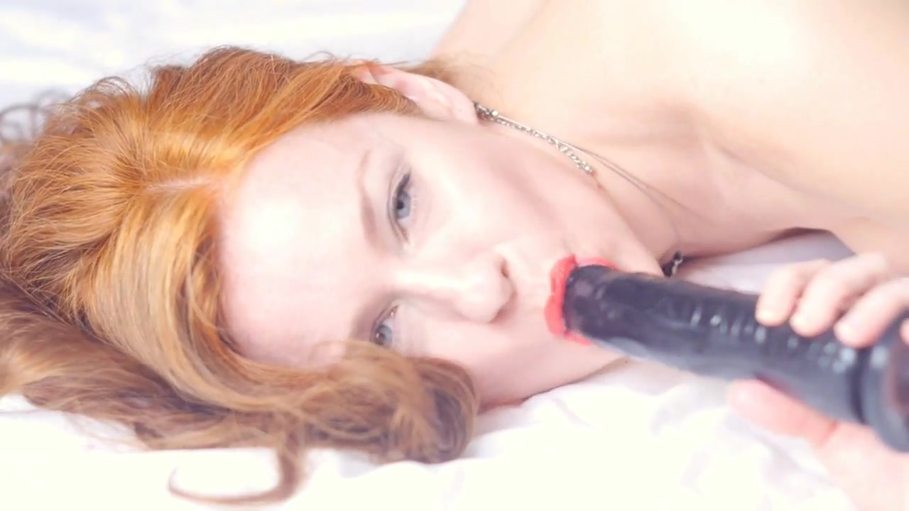 Red head with a black dildo Clothed female riding naked males cock