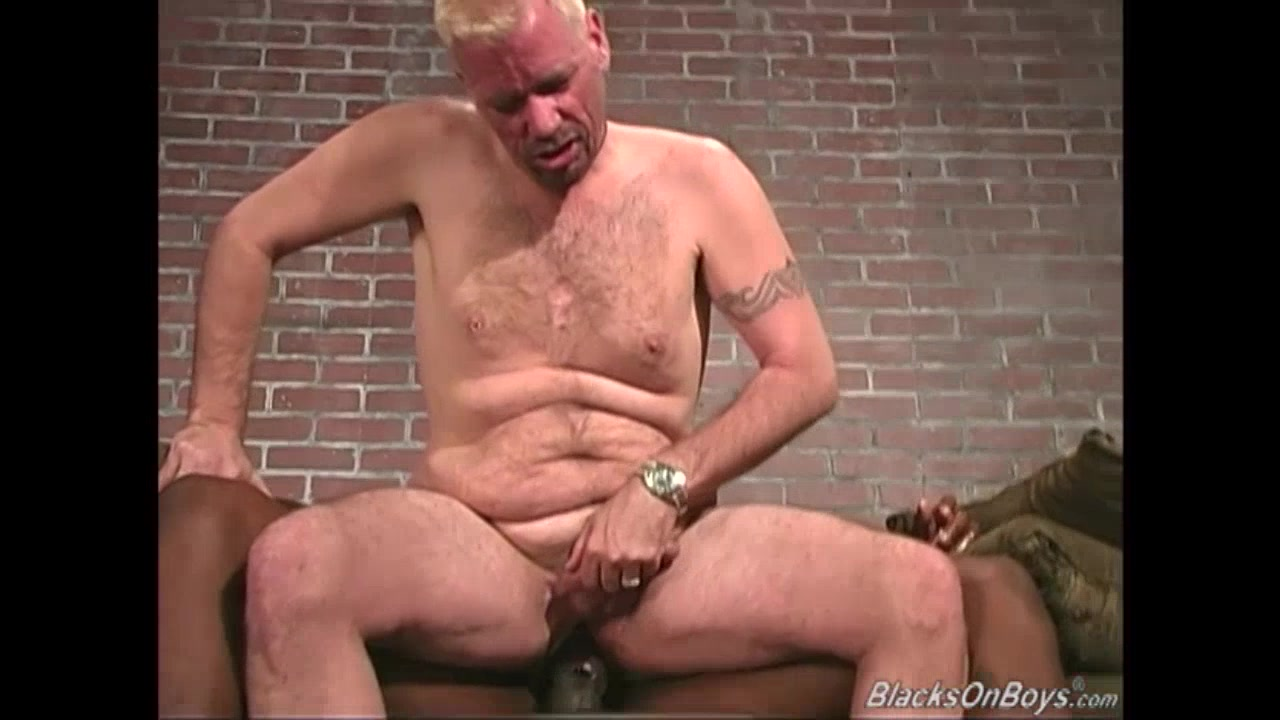 Pierced blonde guy rides a huge black dong hot red head anal