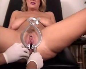 A doll and a monster speculum both in her pussy-wow! biggest penis in the world image
