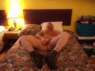 Jerking my cock wearing boots Butt naked lyrics