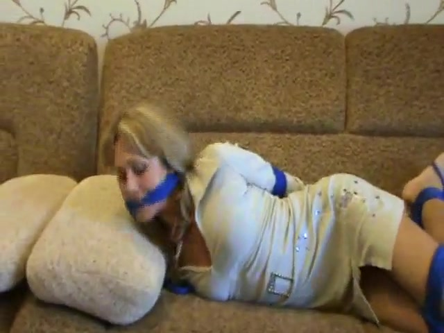Hogtied girl struggles from couch to door naked gun the movie