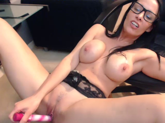 Busty brunette and her kinky toys