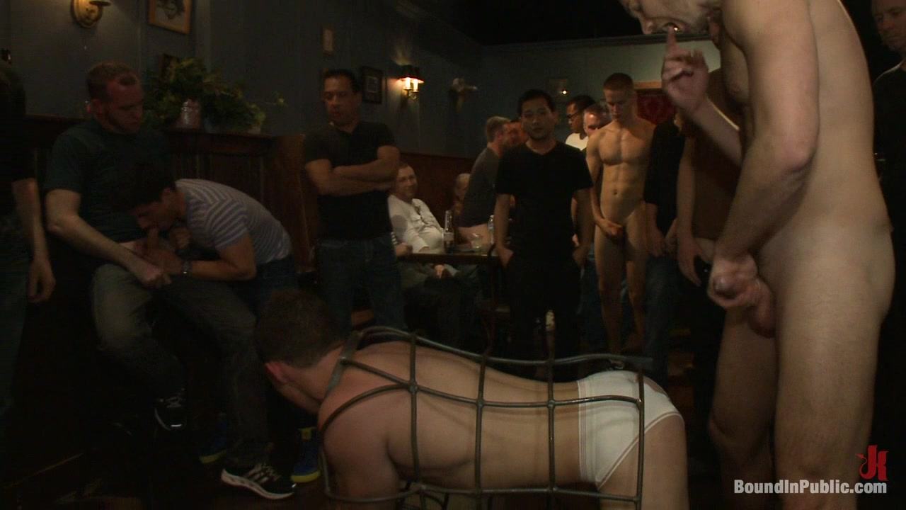 Bound in Public. Stud in a metal cage is fucked by horny bar patrons former miss america porn star