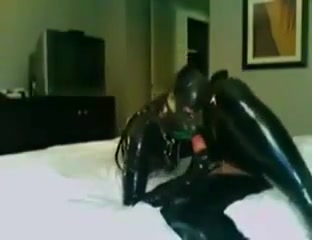 Rubberkitten with Harley Rubber naked sex in the bedroom