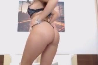 Pretty brunette babe doing a hot masturbation show