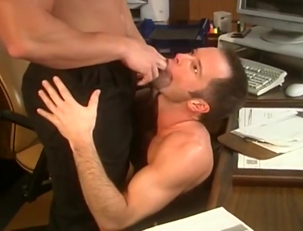 A muscular hunk tops his co-worker in the office boy and a doll