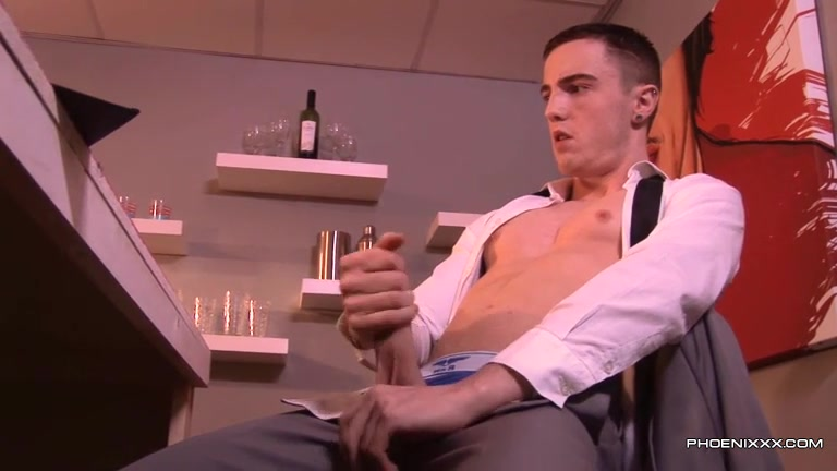 Horny gay dude wanks his nice big dick at the office