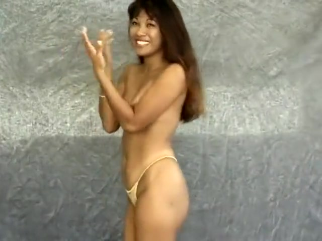 She smiles as the cameras capture her sensual body in all angles