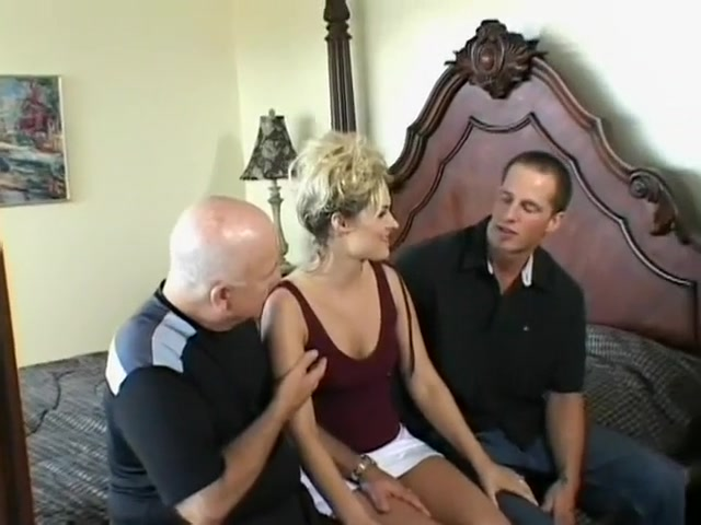 Horny blonde wife has a male pornstar punishing her holes on the bed