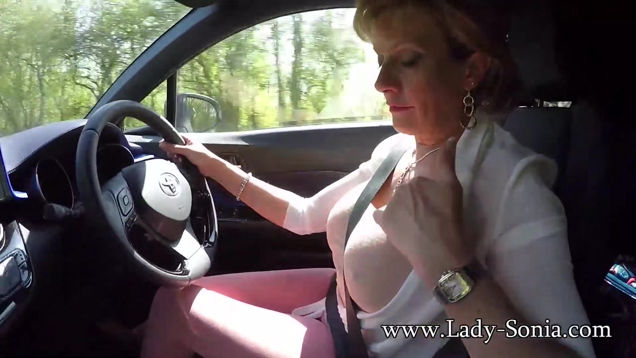 Mature blonde Lady Sonia plays with her tits while driving Frozen penis