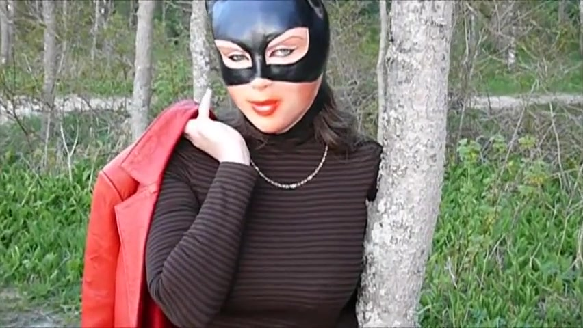 Woman in female mask showing media posts for casey chase creampie xxx