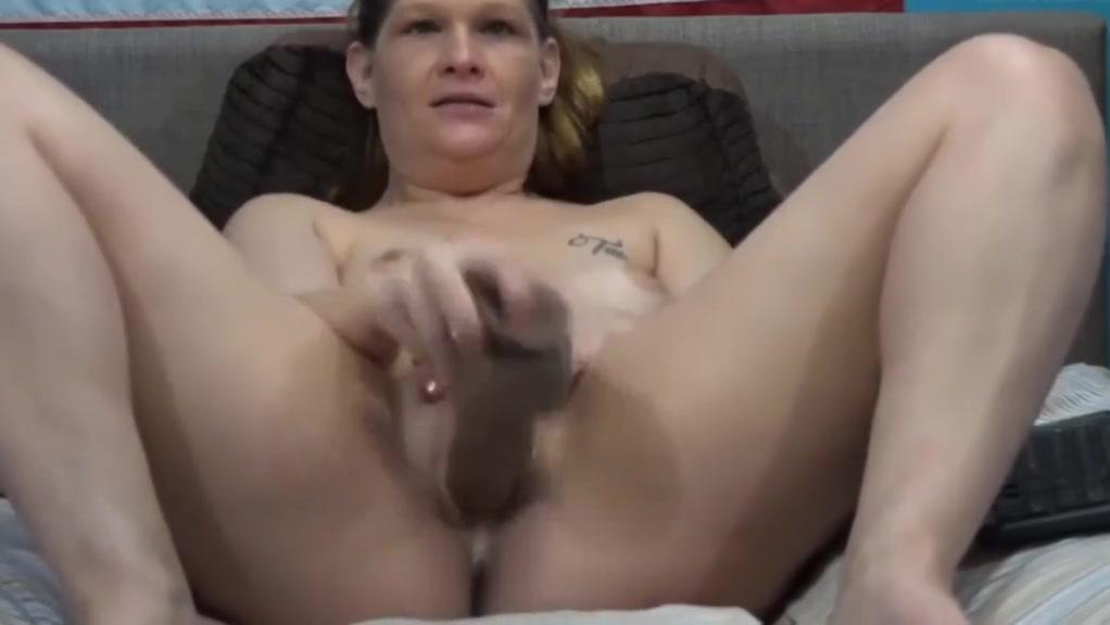 Dirty talking MILF Taz masturbates pierced pussy
