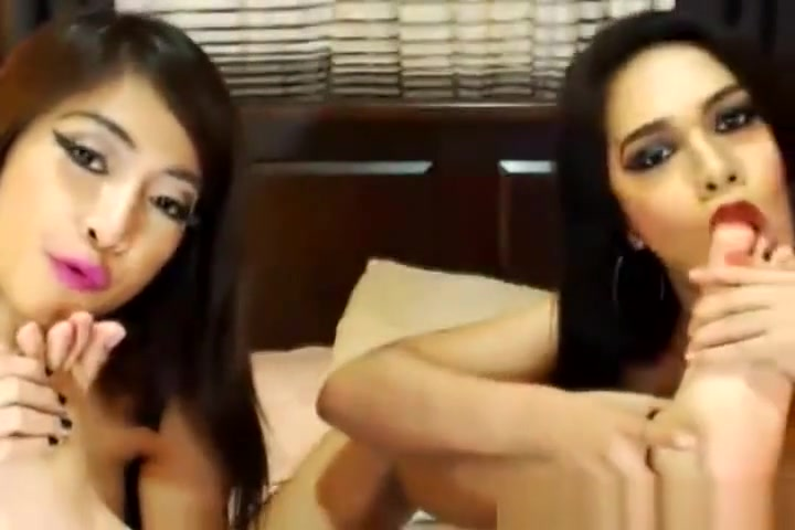 Two wild shemale enjoying their anal sex on cam