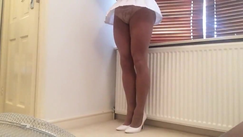 Windy upskirt in white mini and pantyhose . Sexy image wallpaper