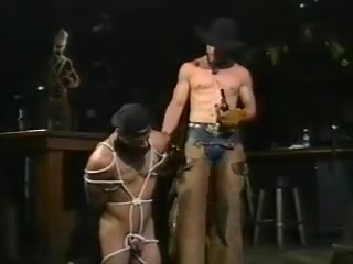 Bondage - Cowboy Master and Boy Slave Sucking a woman's breast