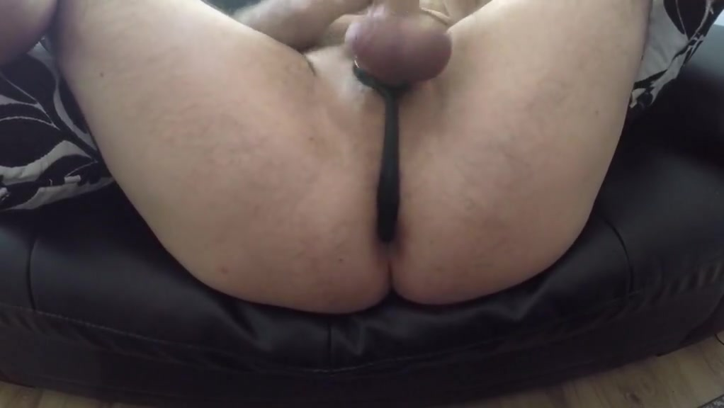 Big Cumshot Orgams Cockring and Butt Plug Guy naked laying down