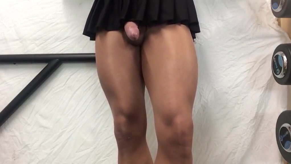 Tan thighs, cock in black mini skirt . Huge all natural boobs