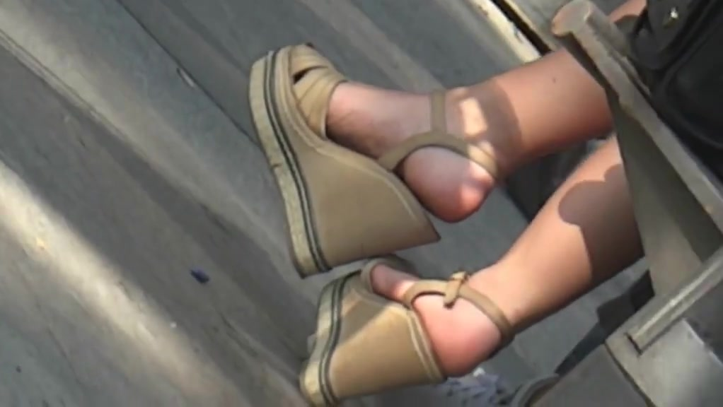 Candid wedges heels with crossed legs