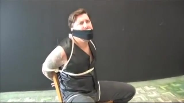 BG Beefy stud in leather vest tied to chair and gagged Prance around show off their asses and pussies